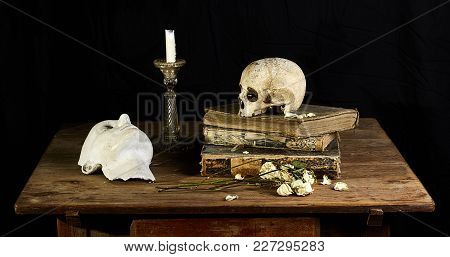 Classical Baroque Still-life In Vantias Style With Skull And Death-mask On A Black Background