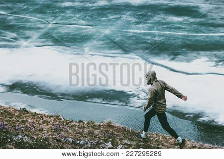 Active Man Running At Frozen Lake Travel Adventure Healthy Lifestyle Concept Vacations Athletic Pers