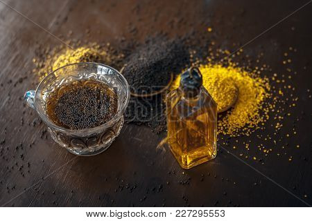 Brown Mustard Seeds,mustard Seed's Oil/tea And Crushed Mustard Seeds On The Brown Wooden Surface.its