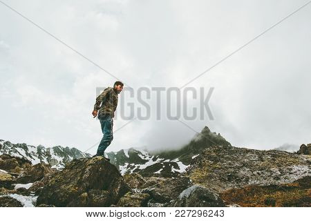 Traveler Man Standing Alone At Foggy Mountains Travel Lifestyle Survival Emotional Concept Adventure