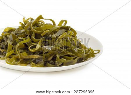 Fragment Of The White Dish With Salad Of Marinated Sliced Laminaria With Vegetable Oil And Spices Cl