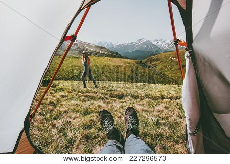 Camping Couple Traveling View From Tent Entrance Woman Walking In Mountains Man Feet Relaxing Inside
