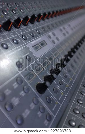 Sound mastering table with many buttons, sliders and leds