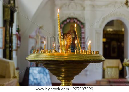 Top Part Of The Candlestand With Burning And Extinguished Candles In The Orthodox Christian Church O