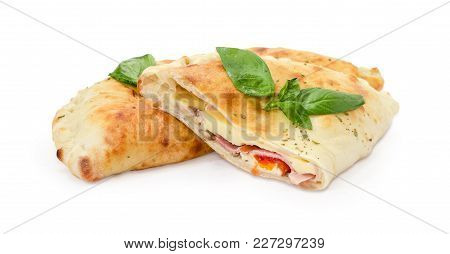 Half Of The Baked Calzone On Background Of Whole Calzone - Closed Type Of Pizza That Is Folded In Ha