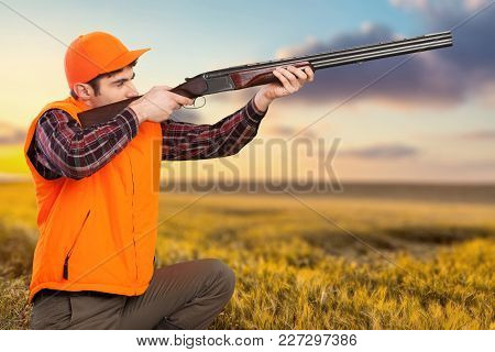 Male Hunter Rifle Green Red Background Sky
