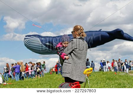 Moscow, Russia - May 27, 2017: Mother With Child Stand Against The Background Of A Huge Whale Kite A