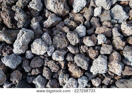 Abstract Background With Dry Reeble Stones With Sharp Shadows
