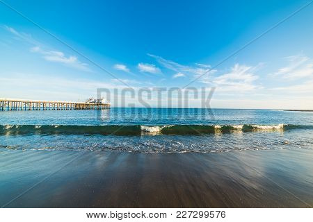 Small Wave By The Pier In Malibu Beach. Los Angeles, California