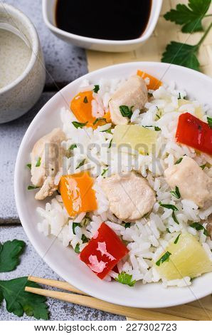 White Rice With Meat, Pepper And Pineapple In A Plate On The Table. Selective Focus.