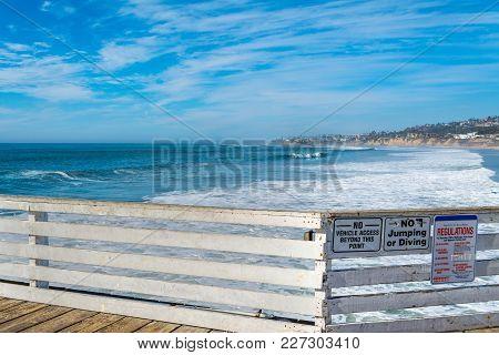 Wooden Railing In Pacific Beach Pier, San Diego. California, Usa