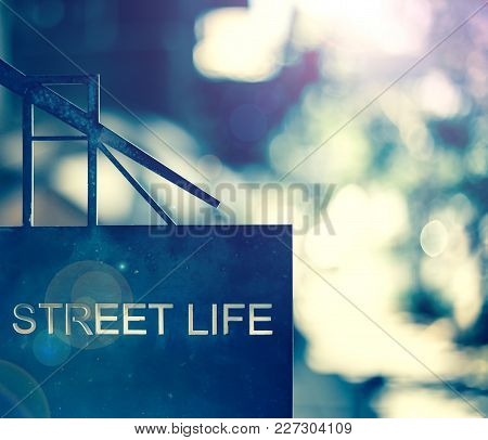 Street Life Sign. The Words Street Life On Metal Sign With Blurred Background.