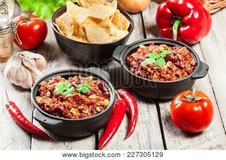Bowls Of Hot Chili Con Carne With Ground Beef, Beans, Tomatoes And Corn