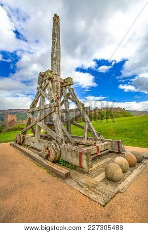 Trebuchet Catapult In A Cloudy Sky In The Yard Of The Urquhart Castle In Scotland United Kingdom. Lo