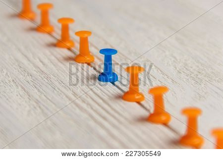 Stationary, Blue Pushpin In Row With Orange, Concept For Difference, Individuality, Leadership. Down