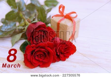 8 march concept. Womens International day celebration background with copy space. Red rose bouquet a