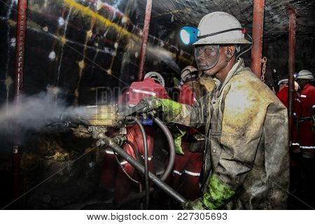 Rustenburg, South Africa; 05/23/2011, Platinum Miners Drilling Holes In Rock For Blasting