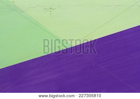 Colorful (violet And Green) Painted Wall With Cracks As Background Or Texture