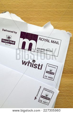 Bracknell, England - February 19, 2018: White Envelopes With Royal Mail Postage Paid And Delivery St