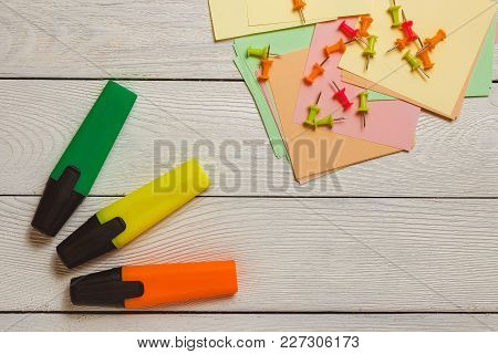 Stationary, Pushpins On Stickers, Colorful Markers, Highlighters On White Wooden Background. Busines