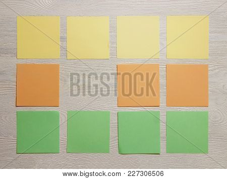 Stationary, Blank Colored Sticker Notes On White Wooden Board. Top View. Flat Lay. Time-management,