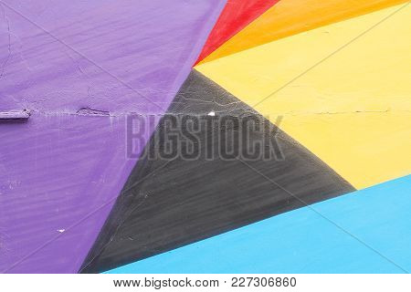 Colorful (violet, Red, Yellow. Black And Blue) Painted Wall With Cracks As Background Or Texture