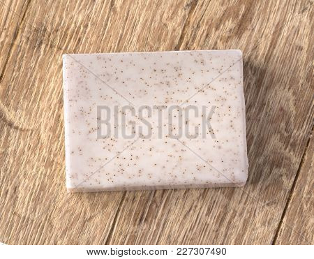 The Cocos  Soap Bar  Over Wooden Background