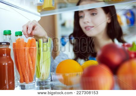 Open refrigerator with fresh fruits and vegetable. Open refrigerator