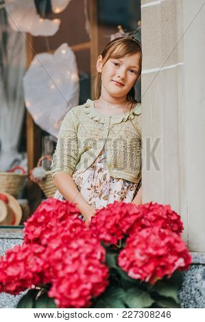 Outdoor Portrait Of Pretty 9-10 Year Old Girl, Wearing Summer Dress