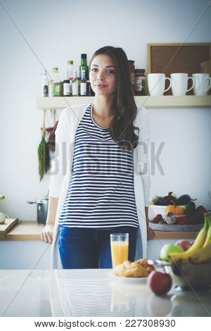 Portrait of a pretty woman holding glass with tasty juice . Portrait of a pretty woman
