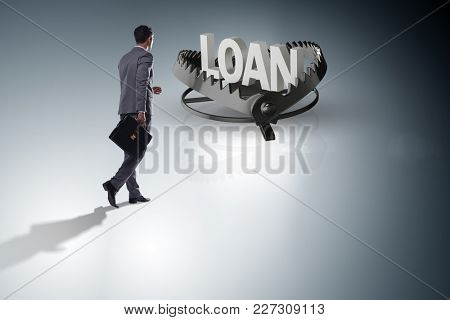 Businessman falling into the trap of loan credit
