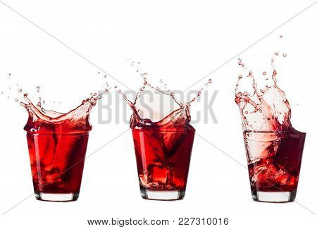 Blueberries Juice Splash Out Of Glass Isolated On White Background.