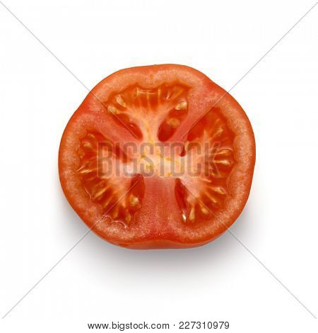 Close-up image of tomato slice from above, on white background