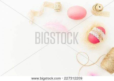 Frame Of Easter Pink Egg With Twine, Feathers And Tapes On White Background, Top View, Fat Lay. East