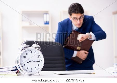 Businessman in rush trying to meet deadline
