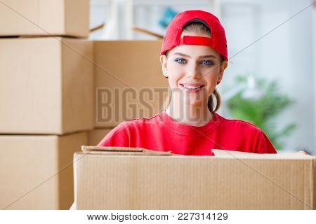 Young woman delivering boxes of personal effects