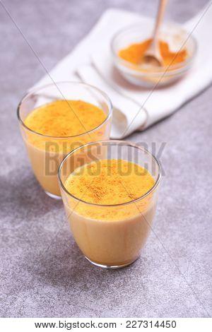 Indian Turmeric Milk With Saffron, Cardamom And Turmeric. Copyspace