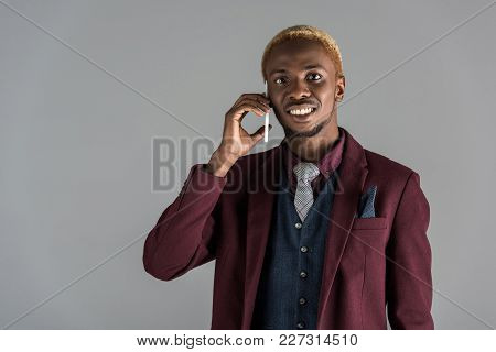 Smiling African American Man Using Martphone On Grey Background