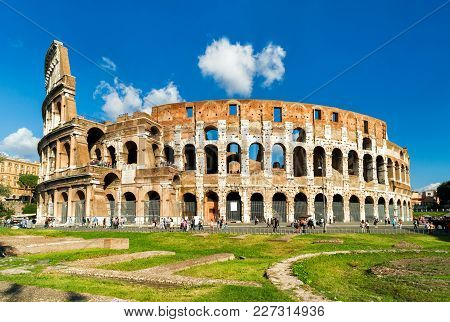 Colosseum Or Coliseum In Rome, Italy. It Is The Main Travel Attraction Of Rome. Colosseum In The Sun