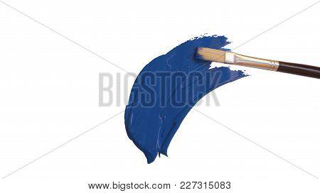 New Wood Paintbrush With Blue Acrylic Paint Streak Painted, Isolated On White Background