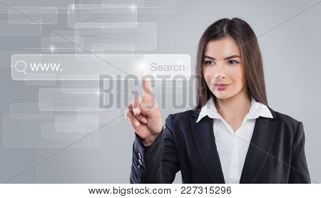 Young Woman Pointing. Www And Web Surfing Concept