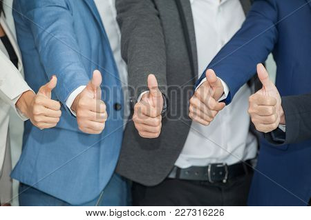 Successful Businessmen And Businesswomen Wear Suit Showing Thumb Up .business People With Colleague