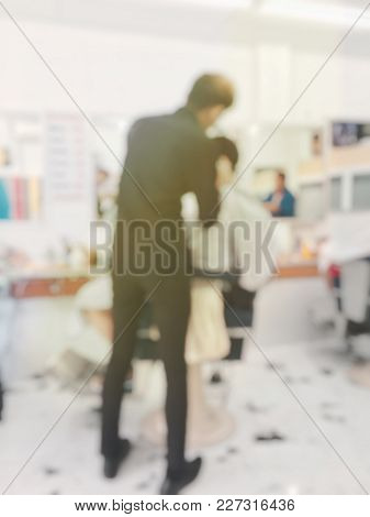 Blurred Image Background Of Asian Man Having A Haircut At Local Barber Shop Or Male Hair Salon. Hair