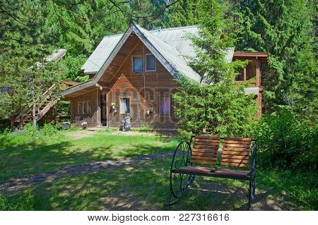 A Village Wooden House  In A Rural Area In The Forest