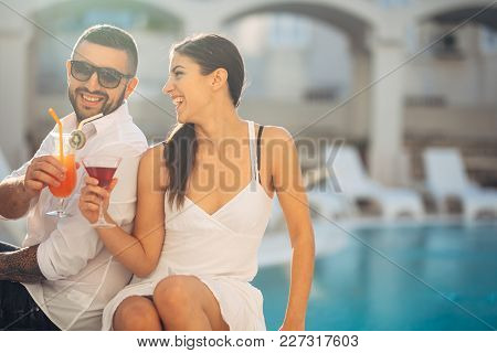 Loving Couple Spending Vacation On Tropical Resort Swimming Pool.newlyweds Honeymoon On Seaside.coup