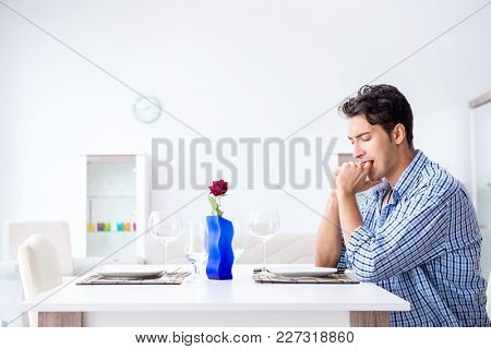 Man alone preparing for romantic date with his sweetheart