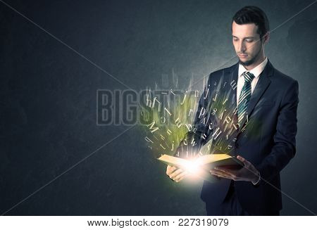 Businessman holding book with letter concept.