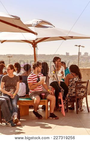 Johannesburg, South Africa - November 2, 2014. People Socialising At A Inner City Event.