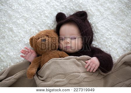 Sweet Little Baby Boy, Dressed In Handmade Knitted Brown Soft Teddy Bear Overall, Sleeping Cozy