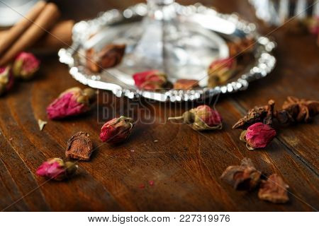 Dried Roses Buds On The Table